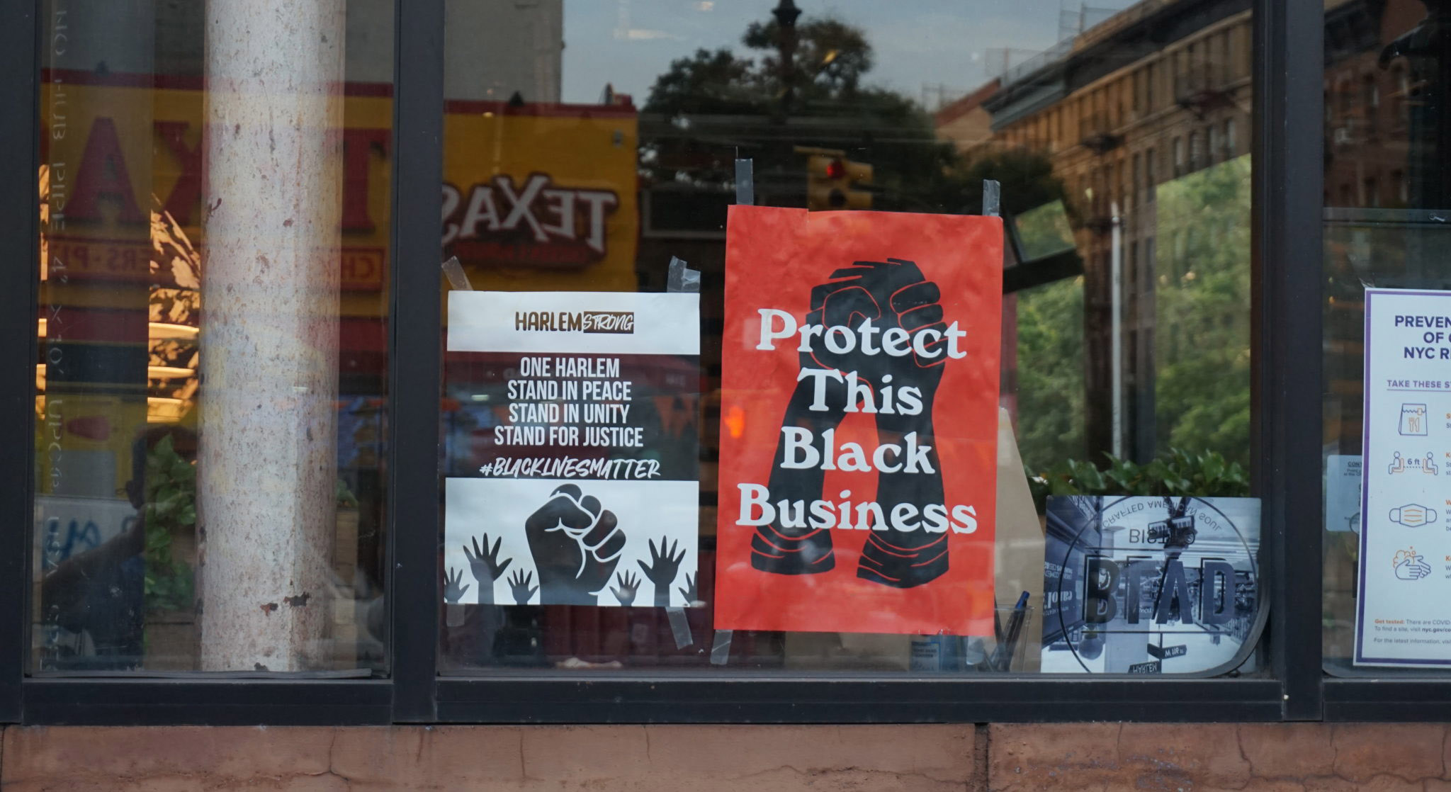 "Signs in window: ""Protect this Black Business"""