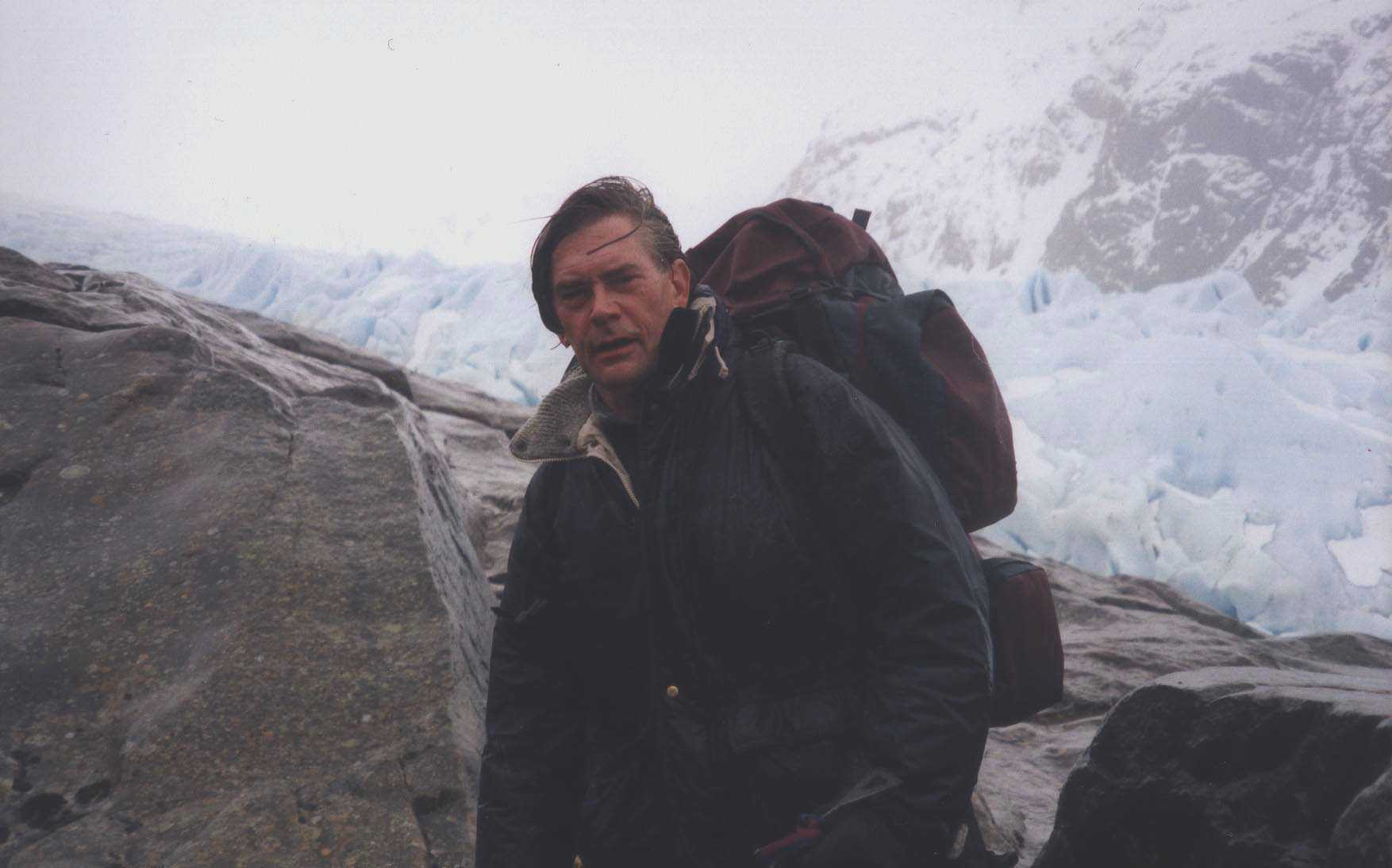 McNiel with backpack on snowy mountain