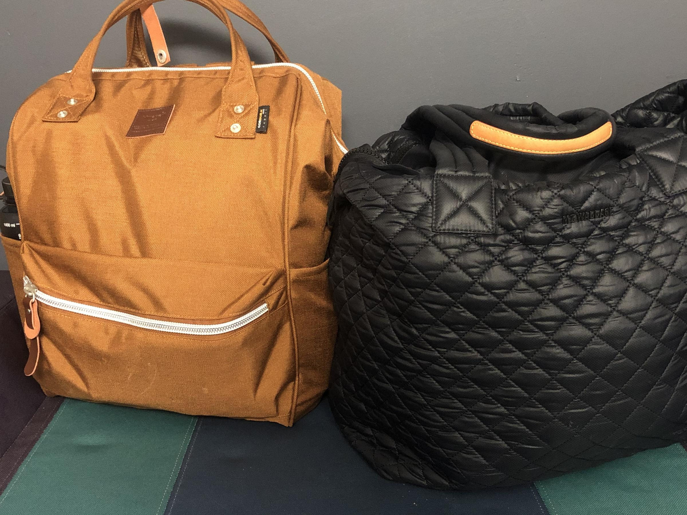a small goldenrod backpack and small quilted black shoulderbag