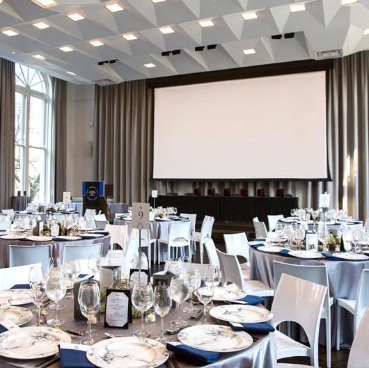Formal dinner setup with round tables: Events at Columbia Journalism School