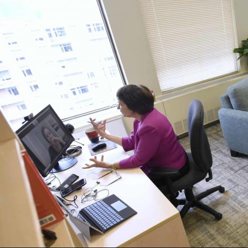 woman in office doing a teleconference