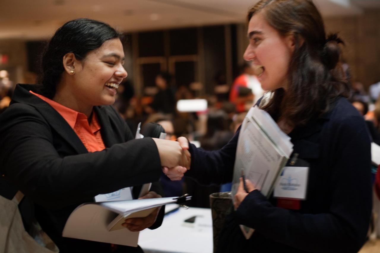 Two students shaking hands at the Career Expo
