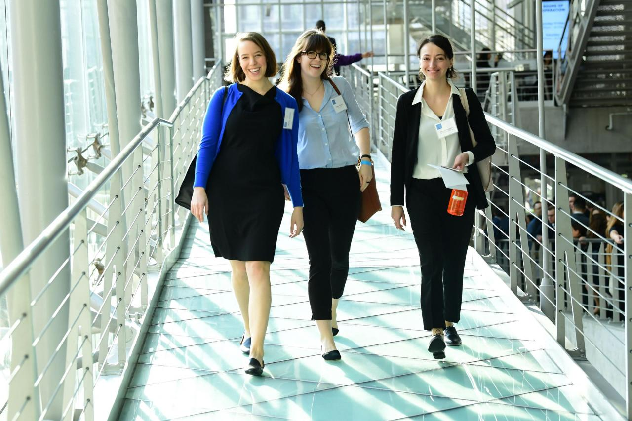 Photo of three students walking down a hallway at the Career Expo
