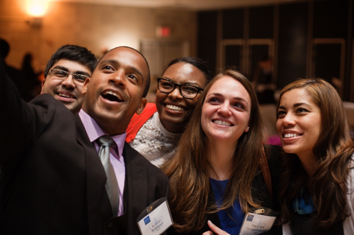 Five Columbia Journalism School alumni pose for a selfie.