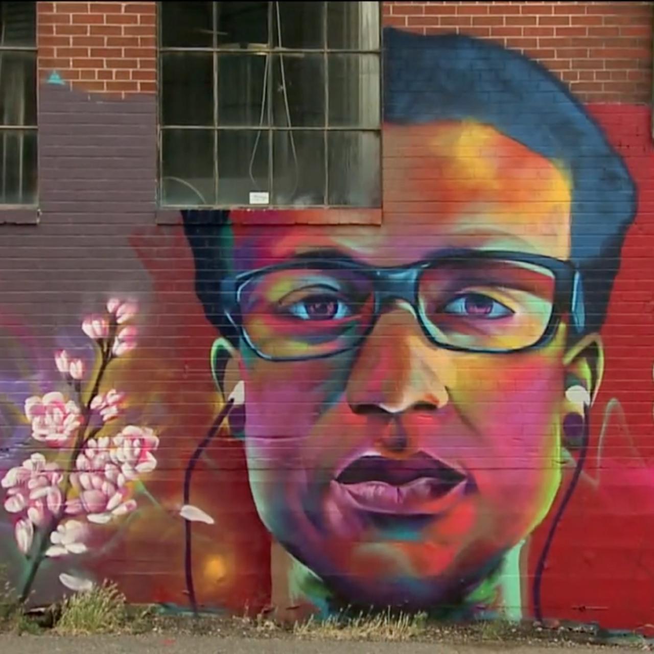 painting of Elijah McClain on brick wall
