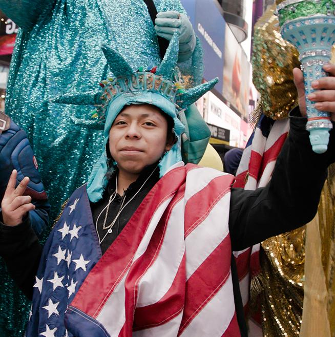 man in flag and Statue of Liberty costume