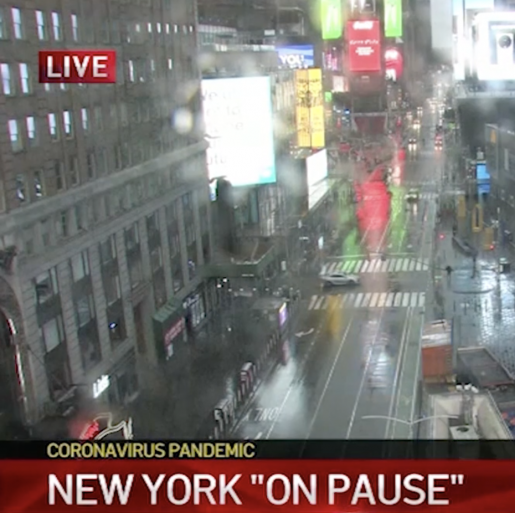 Newscast with banner reading New York On Pause and city street near Times Square