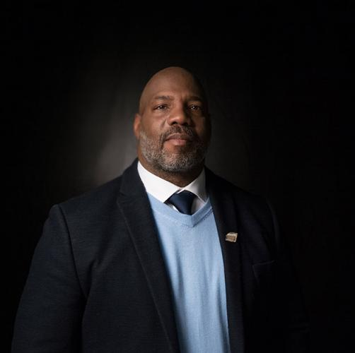 Jelani Cobb in light blue sweater and black suitcoat