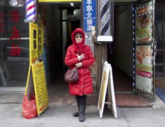 woman in red coat standing outside