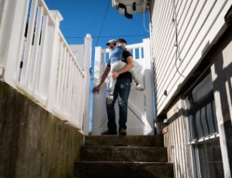 Man and Child atop Stairs: Image from Documented NY Story