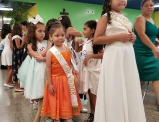 Girls in beauty pageant, one with San Salvador sash, from Documented story