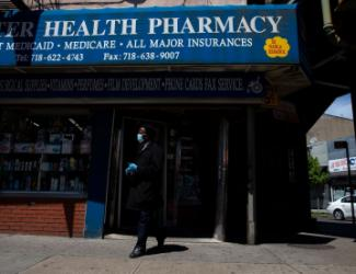 "exterior shot of blue awning reading ""Health Pharmacy"""
