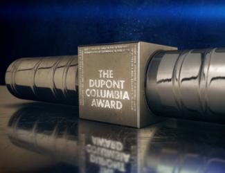 silver duPont baton shadowed on blue background